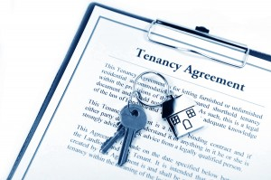 Tenancy agreement and key with symbolic house keyring
